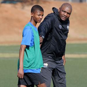 Molefi Ntseki coach of South Africa talking to Kamogelo Pheleu during the South Africa U17 Training Session at the Nike Training Centre , Soweto on the 30 June 2014 ©Muzi Ntombela/BackpagePix