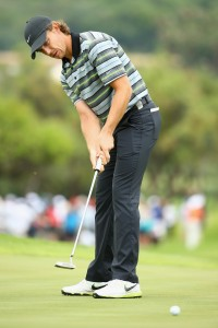 SUN CITY, SOUTH AFRICA - DECEMBER 06:  Tommy Fleetwood of England in action during the third round of the Nedbank Golf Challenge at the Gary Player Country Club on December 6, 2014 in Sun City, South Africa.  (Photo by Richard Heathcote/Getty Images)