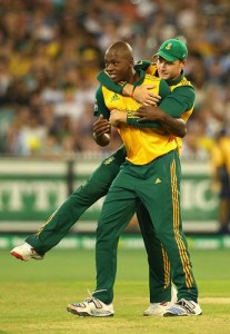 MELBOURNE, AUSTRALIA - NOVEMBER 07:  Kagiso Rabada of South Africa is congratulated by team mates after taking the wicket of Glenn Maxwell of Australia during game two of the International Twenty20 Series between Australia and South Africa at Melbourne Cricket Ground on November 7, 2014 in Melbourne, Australia.  (Photo by Quinn Rooney/Getty Images)